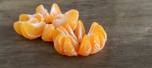 three orange mandarin on the wooden background