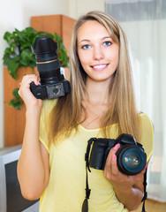 Girl testing  professional cameras