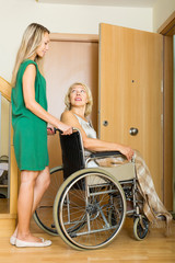 Happy women in wheelchair