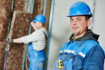 Construction worker at insulation work