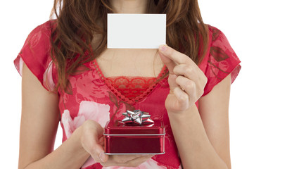 Woman with a gift box showing a blank gift card