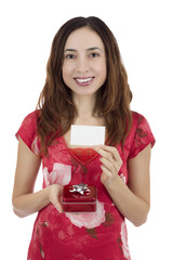 Valentine's day woman with a gift box in her hand showing a gift