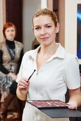 Makeup artist portrait in beauty salon