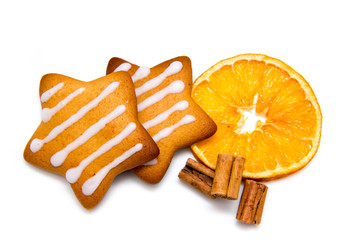 Christmas cookies with orange and cinnamon on white background