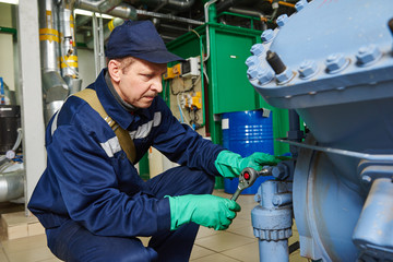 service engineer worker at industrial compressor station