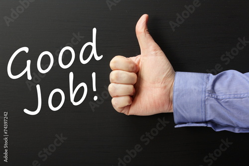 Thumbs up for Good Job done on a blackboard - 74397242