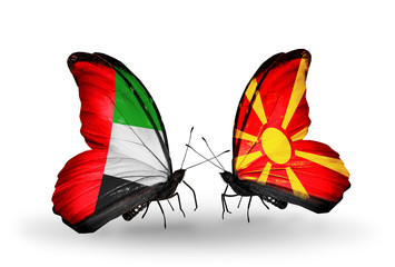 Two butterflies with flags  UAE and Macedonia