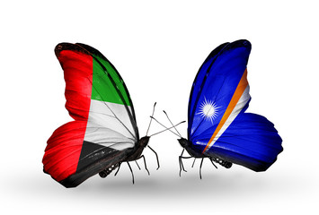 Two butterflies with flags  UAE and Marshall islands