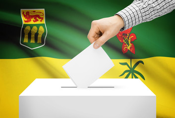 Ballot box with national flag on background - Saskatchewan