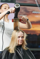 hairdresser at work. Drying hair