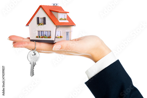 give house and key - concept of real estate purchase - 74399837