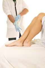 Woman patient legs doctor put on glove