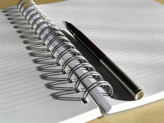 Note book and pen close up