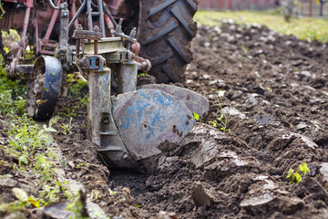 Tractor plowing the land