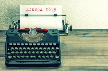Typewriter with white paper page. AGENDA 2015