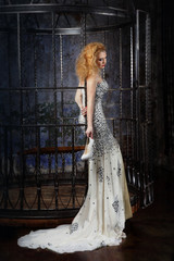 beautiful woman in elegant long dress standing in a half-turn