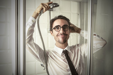 Cheerful businessman in the shower