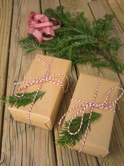 string and brown paper parcels with conifer decoration and check