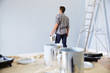 Leinwandbild Motiv Man Decorating Nursery For New Baby
