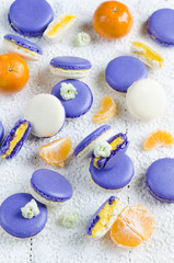 Colored makarons with tangerine ganache