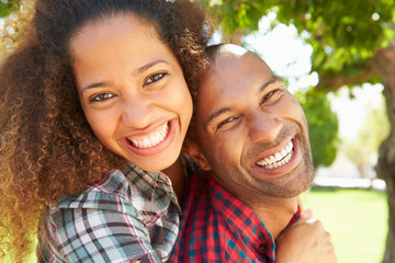 Head And Shoulders Portrait Of Loving Couple Outdoors