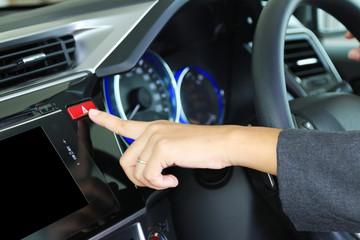Businesswoman finger pressing red triangle car hazard warning bu