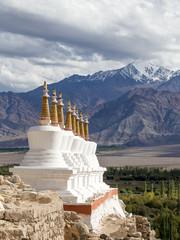Buddhist chortens and Himalayas mountains. Shey Palace, India