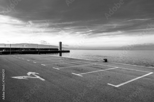 Empty parking area with sea - 74405431