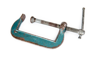 Isolated rusted green vice clamp on white