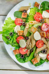 Salad with fresh vegetables and pasta