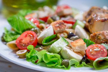 Closeup of cesar salad with vegetables
