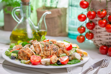 Homemade caesar salad with fresh vegetables