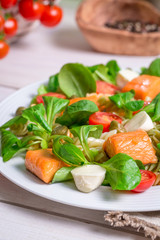Closeup of healthy salad with salmon