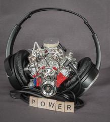 old dusty, miniature  truck engine standing between headphones
