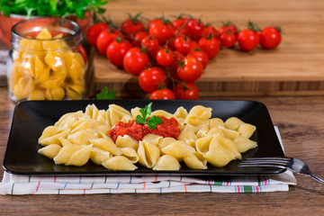 italian pasta with fresh tomato sauce and parsley