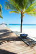Wooden Jetty On Deserted Tropical Palm Beach In Maldives