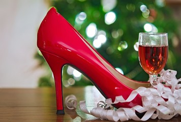 holiday red high heel shoe with wine and ribbons