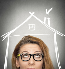 woman looking up house roof above head grey wall background