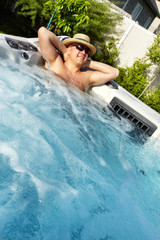 Man having massage in  hot tub spa.