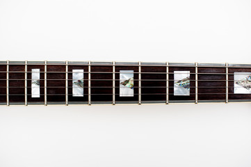 Detail of electric guitar neck and frets