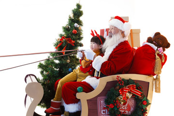 Happy Santa Claus and little girl in Christmas