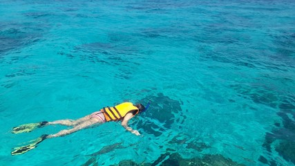 Woman snorkeling in the sea Thailand