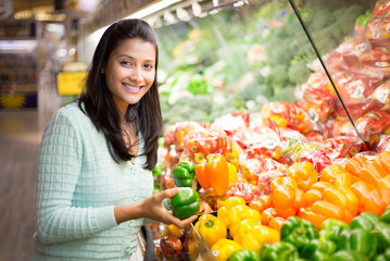Closeup portrait, woman grocery shopping veggies