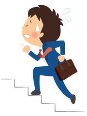 階段を駆け上るサラリーマン
