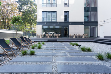 Loungers in front of office building