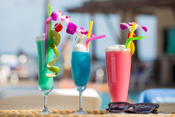 Tropical cocktails with sunglasses on a beach