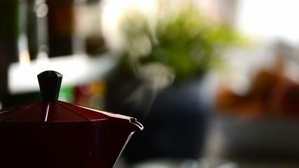 Red moka coffee making coffee in domestic kitchen