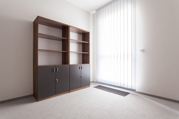 Room with empty shelf