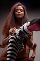 sexy model wearing striped stockings (heels in focus)