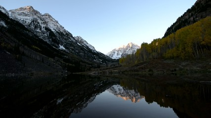 Maroon Bells and its Reflection in the Lake with Fall foliage